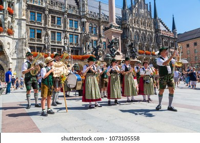 MUNICH, GERMANY - JULY 25, 2017: Music band in traditional bavarian clothes in front of Marienplatz town hall in Munich, Germany in a beautiful summer day