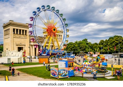 "Munich, Germany - July 26: Fun fair with rides and visitors under the motto ""Sommer in der Stadt - Summer in the city"" on the Königsplatz in Munich on July 26, 2020"