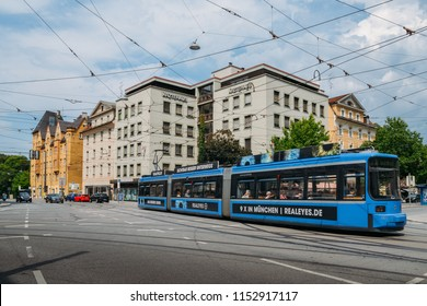 Munich, Germany - July 28, 2018: Blue eletric tram on shopping street in Munich, Bavaria, Germany