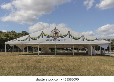 MUNICH, GERMANY - JULY 30, 2015: Building works in preparation of the Oktoberfest 2015 with the buildup of the famous beer tents, roughly 2 months prior start of the folk festival