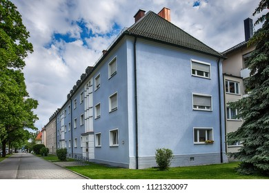Munich, Germany - June 09, 2018: Houses, row of houses in Munich, blue sky. Residential buildings in Munich.
