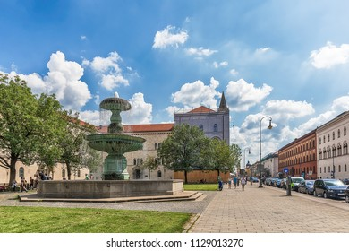 Munich, Germany June 09, 2018: Fountain at Geschwister-Scholl-Platz in Munich. Tourists at the Ludwig Maximilian University of Munich. The university is among the oldest universities of Germany.