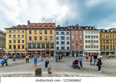 Munich, Germany June 09, 2018: Old houses in the city of Munich at the Residenzstrasse, Germany. People walk through the streets of Munich.