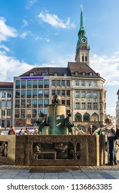 Munich, Germany June 09, 2018: Fischbrunnen (Fish Fountain) fountain and the sculptures on Marienplatz (Mary Square) in Munich in Germany