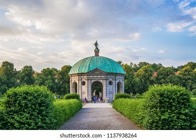 Munich, Germany June 09, 2018: Hofgarten Park with Dianatempel in Munich. People meander about the Diana Pavilion and the grounds of the Hofgarten, adjacent to the Munich Residenz and Odeonsplatz.