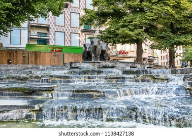 """Munich, Germany June 09, 2018: The Rindermarktbrunnen or literally """"Cattle market fountain"""" in English is a modern sculpture in the historical Altstadt of Munich, in Bavaria, Germany."""