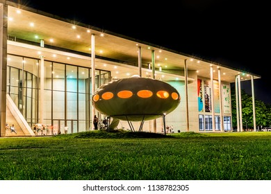 Munich, Germany - June 09, 2018: Building of Pinakothek der Moderne, modern art museum by night in Munich.
