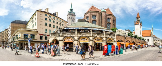 MUNICH, GERMANY - June 11: tourists near New Town Hall at Marienplatz Square in Munich, Bavaria, Germany on june 11, 2018.
