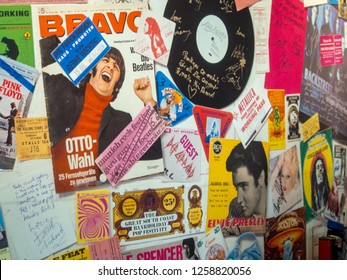 MUNICH, GERMANY - JUNE 12, 2015: Wide closeup of autographs, vinyl records, and other memorabilia on the walls of the Rock Museum at the top of the Olympiaturm. Travel and tourism.