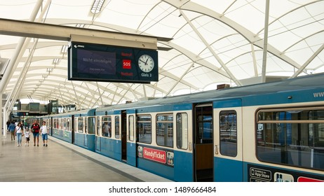 Munich, Germany - June 17, 2018 : A train arriving at Frottmaning station platform. The Allianz Arena Stadium is next to Frottmaning station.