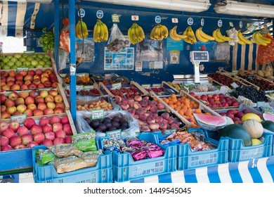 Munich, Germany - June 20, 2018 : Various tropical fruits for selling in walking street stall at Marienplatz, most famous square in the heart of the Munich old town.