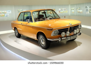 MUNICH, GERMANY - June 2018: BMW Welt museum. Front view of an orange BMW 2002TI, year 1968.