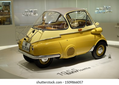 MUNICH, GERMANY - June 2018: BMW Welt museum. Side view of a yellow BMW Isetta, year 1955.