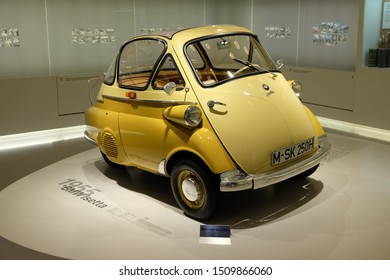 MUNICH, GERMANY - June 2018: BMW Welt museum. Front view of a yellow BMW Isetta, year 1955.