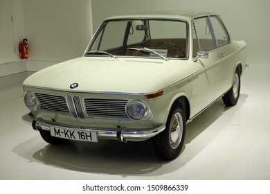 MUNICH, GERMANY - June 2018: BMW Welt museum. Front view of model BMW 1600, year 1966. The car is ivory.