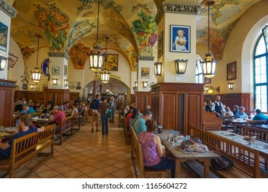 Munich, Germany - June 2018: Interior of famous Hofbrauhaus pub in Munich. Hofbrauhaus is a biggest brewery and beer pub owned by the Bavarian state government in Munich, Bavaria, Germany, Europe
