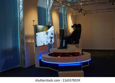 MUNICH, GERMANY - JUNE, 2018: Man experiences the 360 Virtual Reality in German Museum (Das Deutsche museum), the world's largest museum of science and technology, in Munich, Bavaria, Germany, Europe