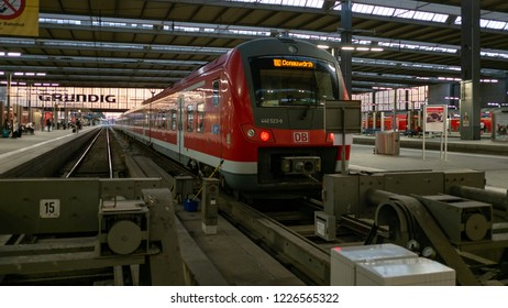 Munich, Germany - June 21, 2018 :Train arriving at Munich main train station or Munich Hauptbahnhof, served by both national and international trains, such as high speed ICE train and City night line.