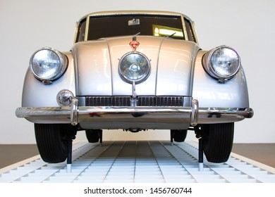Munich, Germany - June 23, 2019: Old white/silver car on the exhibition in Pinakothek der Moderne museum