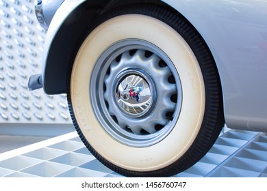 Munich, Germany - June 23, 2019: Old white/silver wheel of the car on the exhibition in Pinakothek der Moderne museum