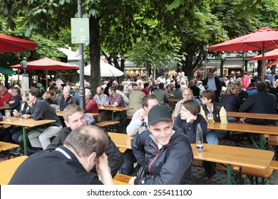 MUNICH, GERMANY - JUNE 25, 2013: Beer Garden at the viktualien markt. The viktualien markt is situated in the center of the city and houses a big beer garden.