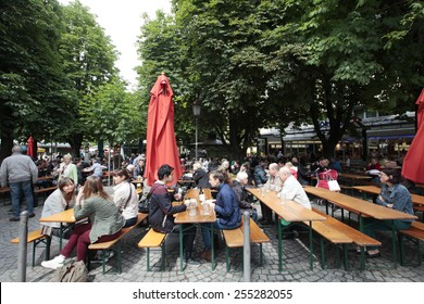 MUNICH, GERMANY - JUNE 26, 2013: Beer Garden at the Viktualien markt. The viktualien markt is situated in the center of the city and houses a big beer garden.