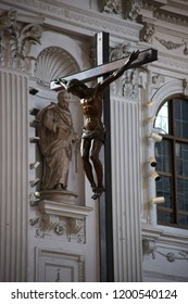 MUNICH, GERMANY - JUNE 29: Cross with crucified Jesus in the sacral ornate interior of St. Michael's Church on June 29, 2018 in Munich.