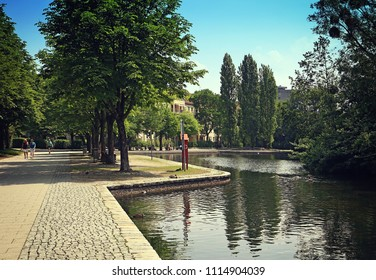 MUNICH, GERMANY - JUNE 6, 2018 Idyllic view of Schwabinger See, small artificial lake in Schwabing quarter,  linked to the water canal system in Munich