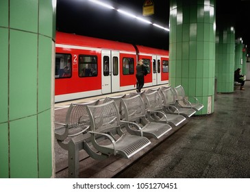 MUNICH, GERMANY - MARCH 13, 2018, Isartor underground station for the S-line in Munich with train at the platform