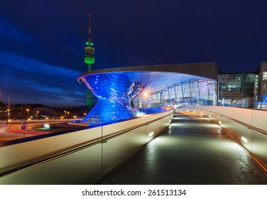 MUNICH, GERMANY - MARCH 17, 2015: BMW World (BMW Welt) with Olympic Tower illuminated in green on St. Patrick's Day.