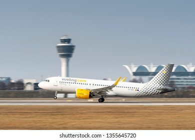 Munich, Germany - March 24. 2019 : Vueling Airbus A320-271N with the aircraft registration EC-NAX is starting on the southern runway 26L of the Munich airport MUC EDDM
