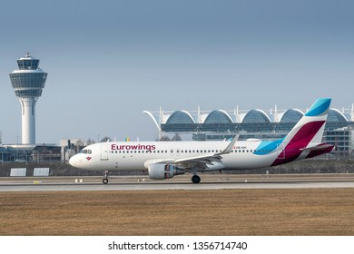 Munich, Germany - March 24. 2019 : Eurowings Europe Airbus A320-214 with the aircraft registration OE-IQC is landing on the southern runway 26L of the Munich Airport MUC EDDM