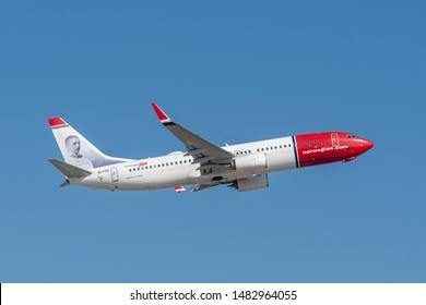 Munich, Germany - March 31. 2019 : Norwegian Air International Boeing 737-8JP with the aircraft registration number EI-FHU during take off on the southern runway 08R of the Munich Airport MUC EDDM