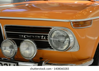 MUNICH, GERMANY - MARCH 5, 2016: BMW 2002 TI classic German luxury 1960s New Class car headlight in the BMW Museum. The BMW 02 Series is a range of compact executive cars produced by BMW till 1977.