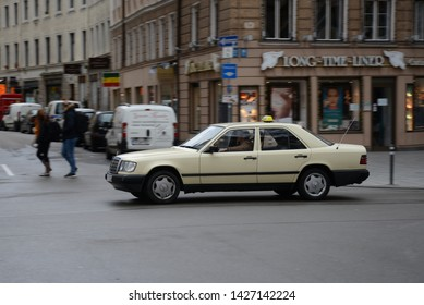 MUNICH, GERMANY - MARCH 6, 2016: Old Mercedes-Benz W124 E-Class Taxi car on the city street