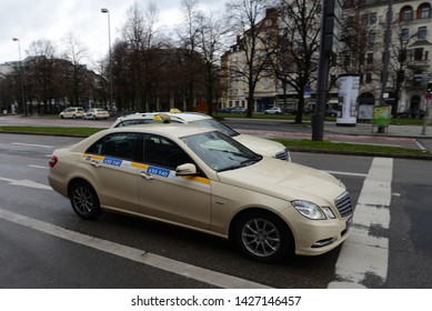 MUNICH, GERMANY - MARCH 6, 2016: Mercedes-Benz E-Class Taxi on the city street in classic German color scheme
