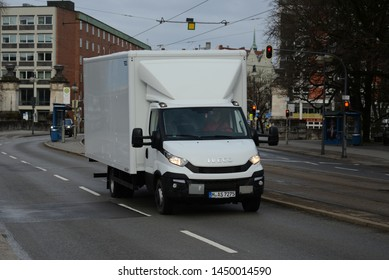 MUNICH, GERMANY - MARCH 6, 2016: Iveco Daily white van truck on the city street at work