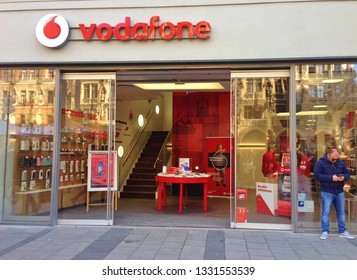 Munich, Germany - March,2019: Storefront of Vodafone shop with logo and red brand name at Munich Marienplatz. Vodafone is a famous British telecommunications and IT services company for mobile phones