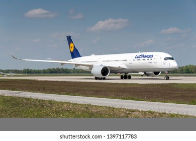 Munich, Germany - May 02. 2019 : Lufthansa Airbus A350-941 with the aircraft registration number D-AIXH is taxiing for take off on the northern runway 26R of Munich Airport MUC EDDM