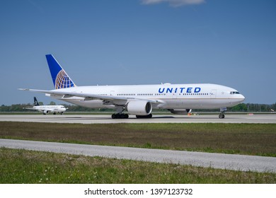 Munich, Germany - May 02. 2019 : United Airlines Boeing 777-222 with the aircraft registration number N788UA is taxiing for take off on the northern runway 26R of Munich Airport MUC EDDM