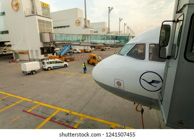 """Munich, Germany - May 03, 2016: exterior of a cockpit of an aircraft of the brand """"Lufthansa"""" at the terminal of the airport """"Franz Josef Strauss"""" - """"Lufthansa"""" logos can be seen at the buildings, too"""