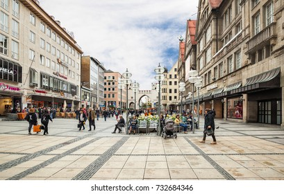 Munich, Germany - May 04, 2017: People walk along the main street of Munich with its shops and restaurants