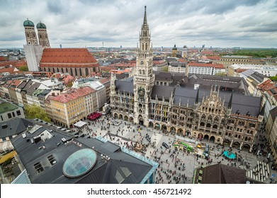 Munich, Germany - May 05, 2015: Aerial cityscape from the tower a cloudy day. City hall, Cathedral and St Peters church are around MarienPlatz, the first touristic and commercial attraction in Munich.