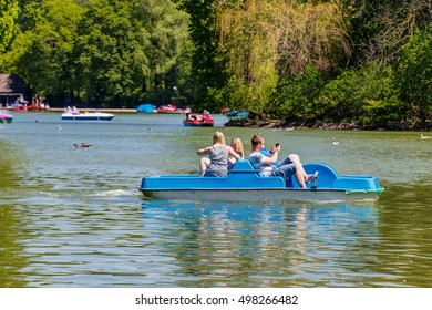 MUNICH, GERMANY - MAY 07, 2016: People enjoying the sunny day with family and friends in English garden, famous city park.