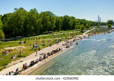 "MUNICH, GERMANY - MAY 08, 2016: People enjoying the sunny day with family and friends near ""isar"" river."