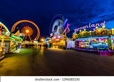 MUNICH, GERMANY – MAY 10 2019: The annual spring festival taking place at the Theresienwiese with a lot of amusement rides.