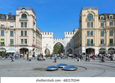 MUNICH, GERMANY - MAY 16, 2017: Karlsplatz square (more often called Stachus) and Karlstor gate in sunny day. The gate was built between 1285 and 1347, and first mentioned in documents in 1302.