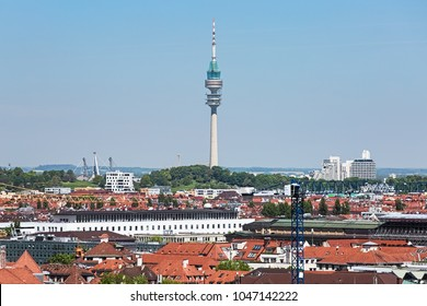 MUNICH, GERMANY - MAY 17, 2017: Olympiaturm TV tower (Olympic Tower) in Olympic Park. Telephoto view from the tower of New Town Hall. The TV tower with height of 291 m (955 ft) was built in 1965-1968.