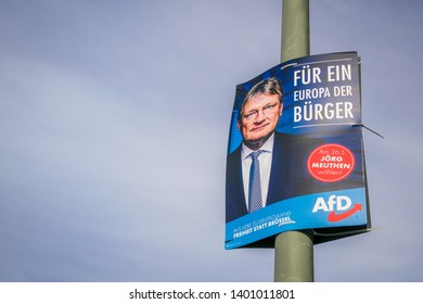 Munich, Germany - May, 2019: An election campaign poster of Joerg Meuthen, lead candidate for the right-wing populist Alternative for Germany (AfD) party, sits on a lamppost. EU Parliament elections.