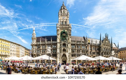 MUNICH, GERMANY - MAY 22: tourists near New Town Hall at Marienplatz Square in Munich, Bavaria, Germany on ma 22, 2018.